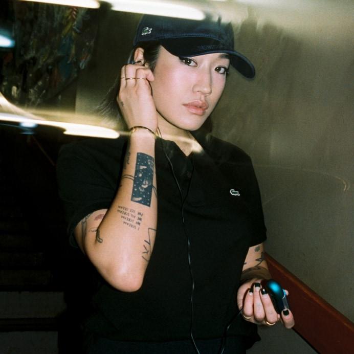 black short sleeve polo shirt worn by Peggy Gou